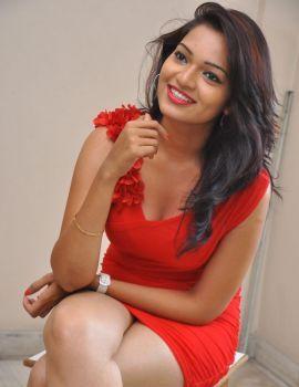 Actress Ashwini in Red Dress at Veerudokkade Telugu Movie Audio Launch