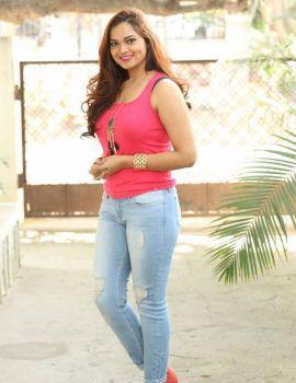 Tamil Actress Ashwini Latest Stills in Pink Sleeveless T-Shirt