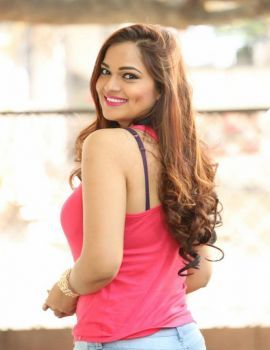 Tamil Actress Ashwini Latest Stills in Pink Sleeveless T-Shirt