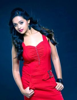Actress Bhavana Stills in Red Dress
