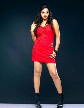 Actress Bhavana Stills in Red Dress
