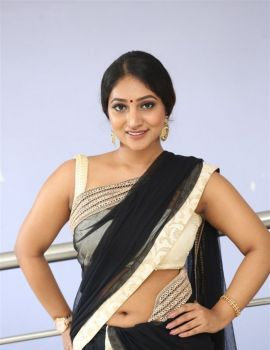 Bommu Lakshmi in Saree Pics at 90ML Movie Audio Launch