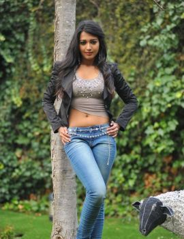 Catherine Tresa posing in Black Jacket and Blue Jeans