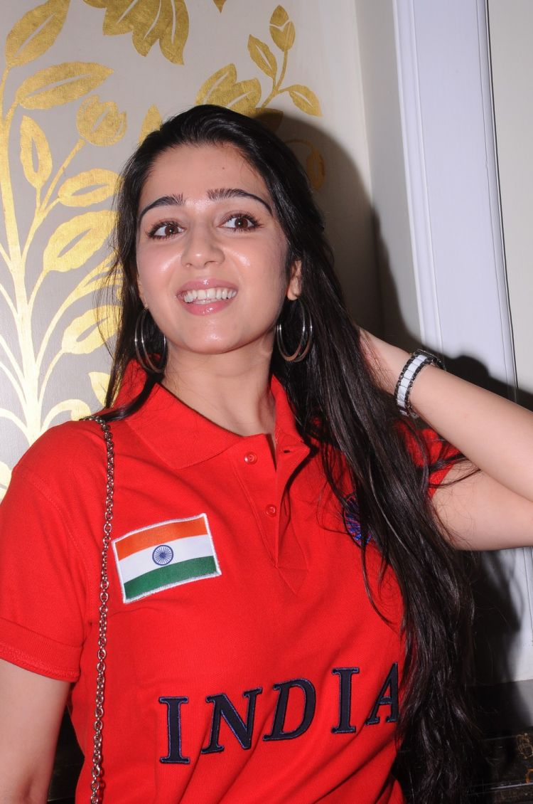 Charmi at Indian Brand Launch in Red T Shirt and denim