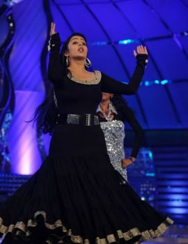 Charmi in Black Dress at a Stage Performance