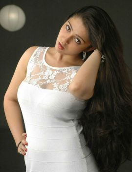 Charmi Latest White Dress Stills from Telugu Movie Mangala