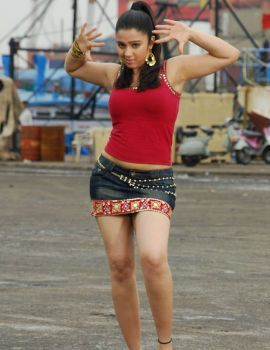 South Indian Actress Charmi Kaur Stiils in Red Top