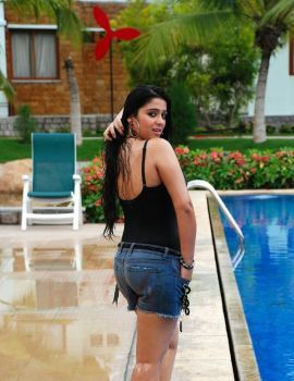 Telugu Actress Charmi Kaur in Swimming Pool