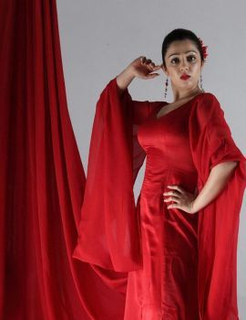 Telugu Heroine Charmi Stills in Long Red Dress