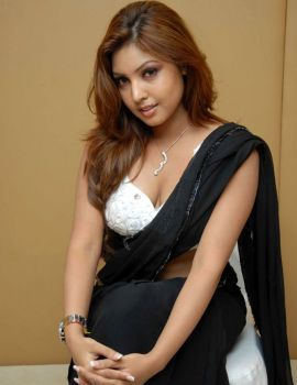 Actress Komal Jha in Black Saree Photoshoot Stills
