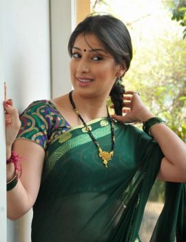 Lakshmi Rai in Green Saree at Rani Ranamma Muhurat