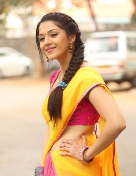 Mehreen in Yellow Saree at Krishna Gadi Veera Prema Gadha Press Meet
