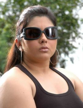Namitha latest hot photos stills in tanktop and tight jeans from Telugu movie Sukra
