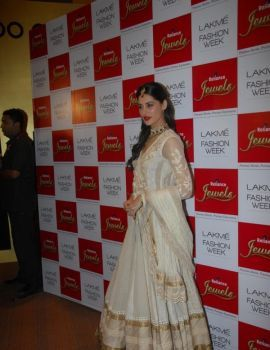 Nargis Fakhri walks the ramp as show stopper displaying Designer Ritu Kumar's Collection