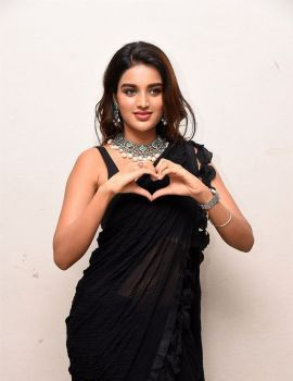 Nidhhi Agerwal in Black Saree at Ismart Shankar Pre-Release Event