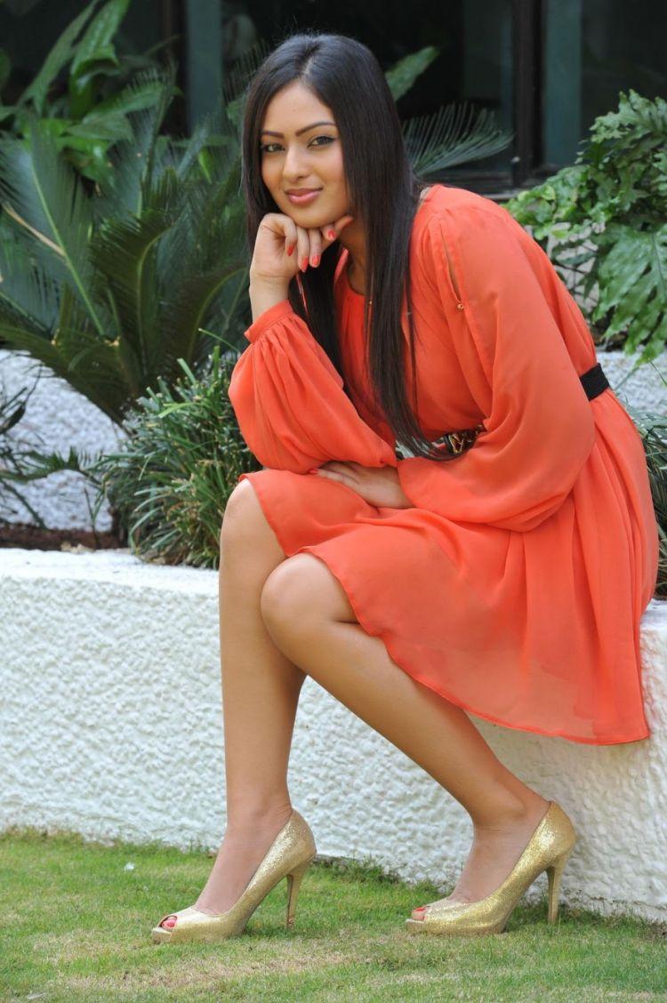 Actress Nikesha Patel Stills in Orange Dress
