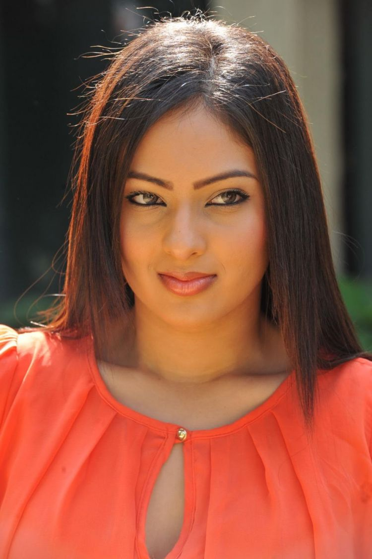 Actress Nikesha Patel Stills in Orange Dress