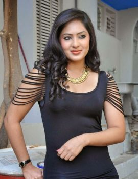Nikesha Patel Latest Stills in Black Short Dress