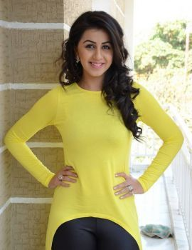 Glamorous South Indian Actress Nikki Galrani in Yellow Dress