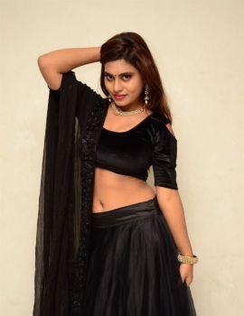 Priyanka Augustin Stills in Black Dress at Mass Power Movie Press Meet