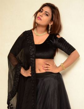 Priyanka Augustin Stills in Black Dress at Mass Power Movie Press Meet
