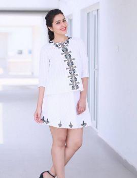 Tollywood Actress Raashi Khanna Stills in White Mini Skirt