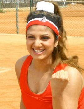 Actress Rambha playing Tennis