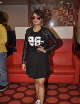 Richa Chadda in a Black Short Dress at Red FM Studio