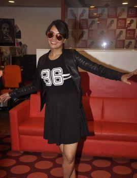 Richa Chadda in a Black Short Dress at Red FM Studio