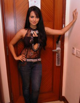 Sana Khan in Transparent Black Top and Blue Jeans