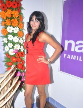 Sanjana Latest Stills in Red Dress at Naturals Family Salon Launch