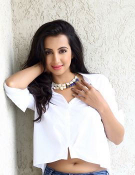 Sanjjanna Galrani Trendy White Shirt and Blue Jeans Photoshoot Stills