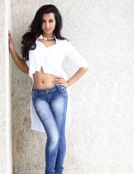 Sanjjanna Galrani Trendy White Shirt and Blue Jeans Photoshoot Stills