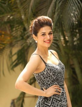 Telugu actress Shraddha Das Stills at Guntur Talkies Pre-Release Press Meet