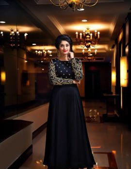 Surbhi in Black Long Dress at Andagathey Audio Launch