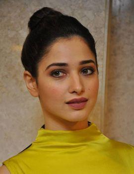 Tamanna Bhatia in Yellow Gown at Okkadochadu Audio Launch