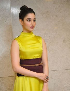 Tamanna Bhatia in Yellow Gown at Okkadochadu Audio Launch