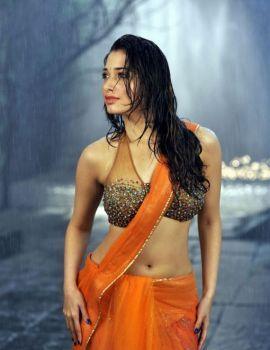 Tamannah in Wet Orange Saree in Telugu Movie Racha