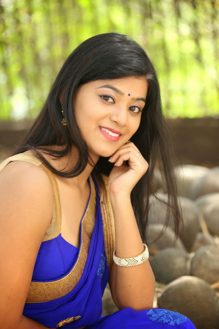 Yamini Bhaskar Glamorous Stills in Blue Saree at Racha Rambola Muhurat