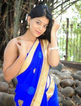Yamini Bhaskar Glamorous Stills in Blue Saree at Racha Rambola Muhurat